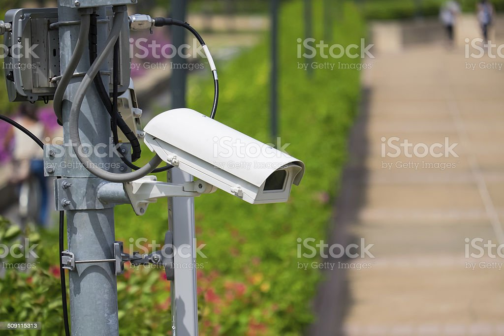 Security surveillance camera  in the park stock photo
