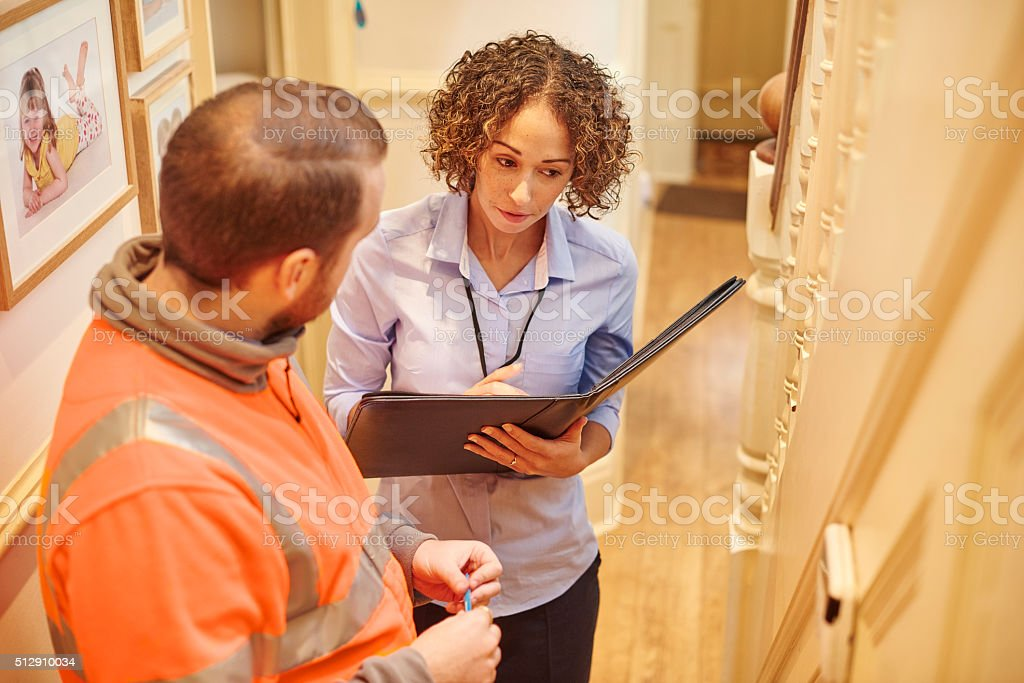 security system install with housing officer stock photo