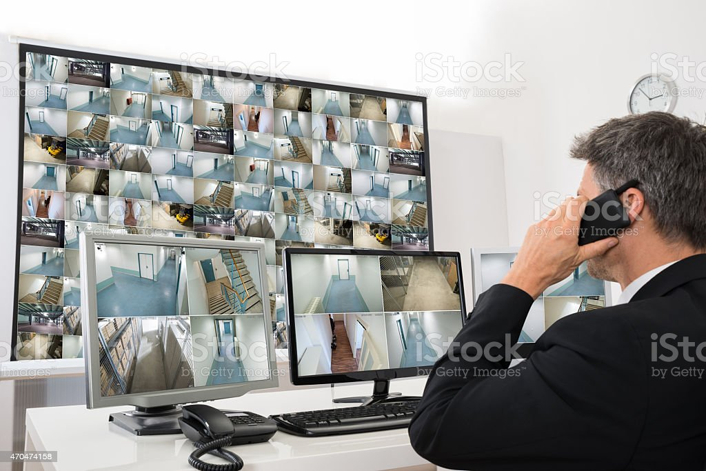 Security System Operator Looking At Cctv Footage stock photo