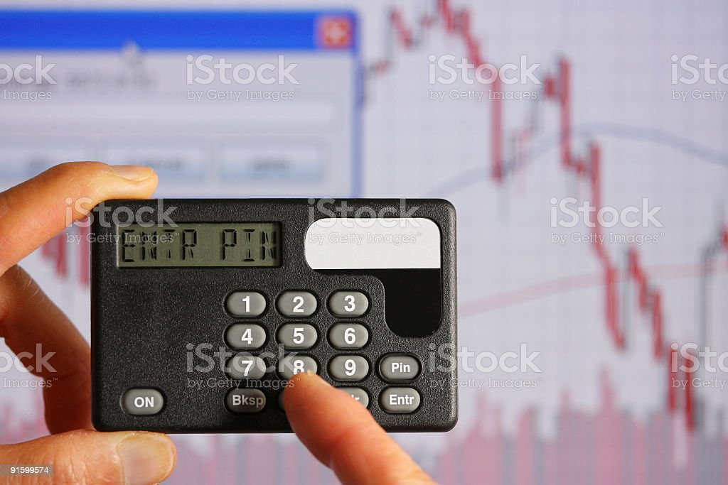 Security token with stock chart in background stock photo