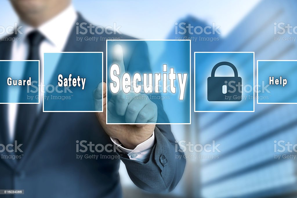 Security touchscreen is operated by businessman stock photo