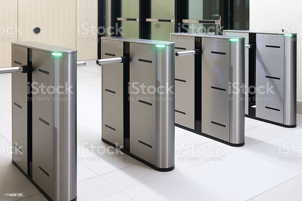 Security turnstyle in corporate environment stock photo