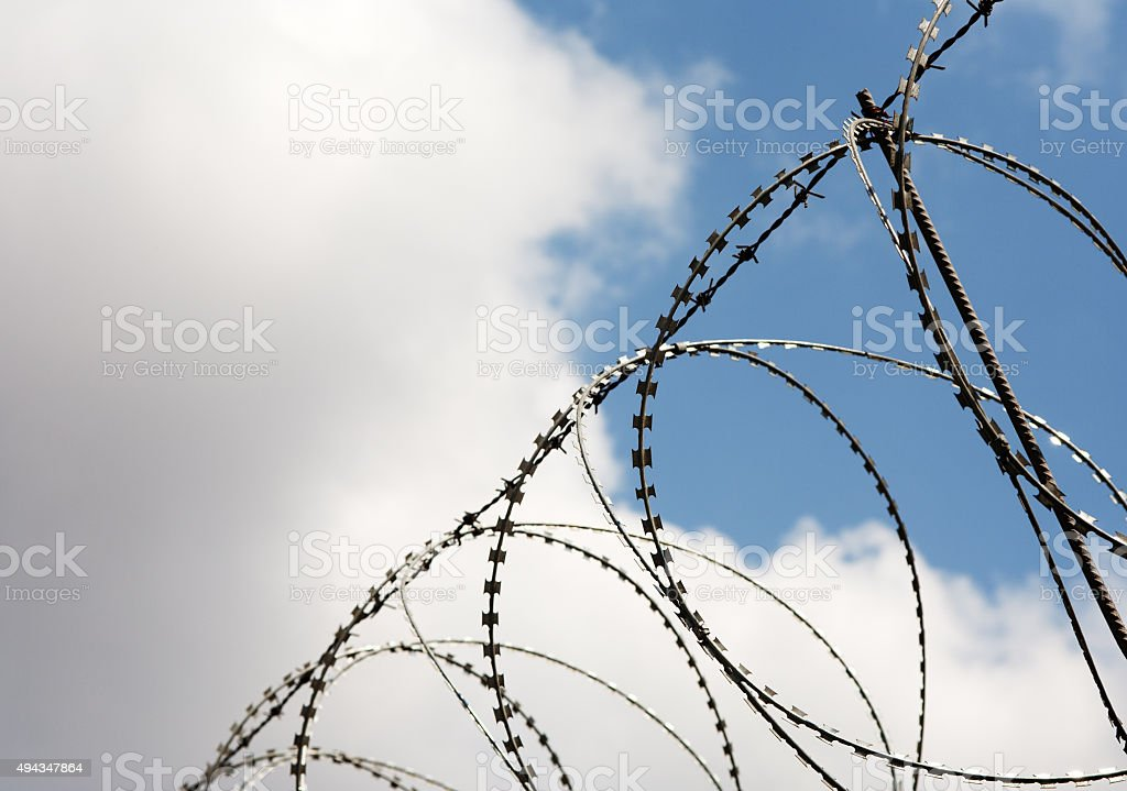 Security with a barbed wire fence. stock photo