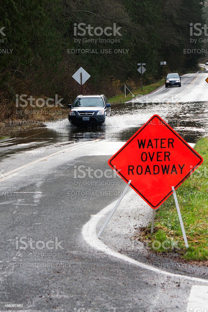 Sedan Crossing Flooded Carnation Farm Road stock photo