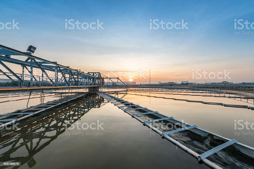 sedimentation basin, sewage flowing through large tanks stock photo