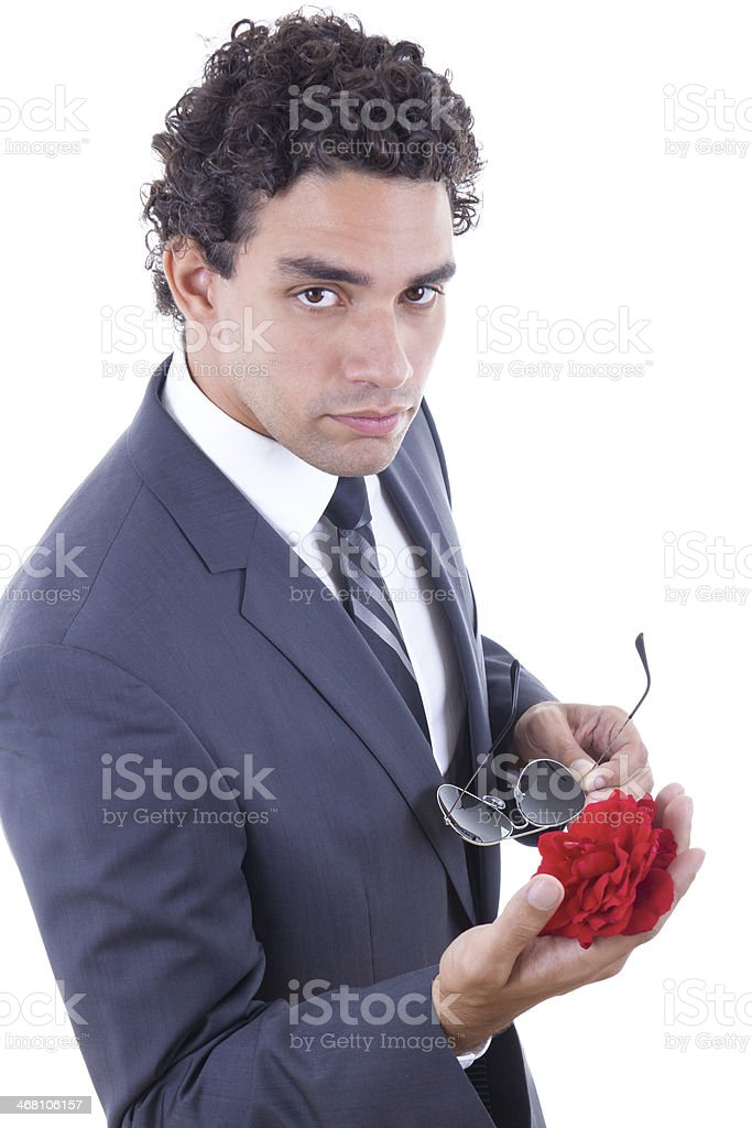 seducer in suit holding rose stock photo
