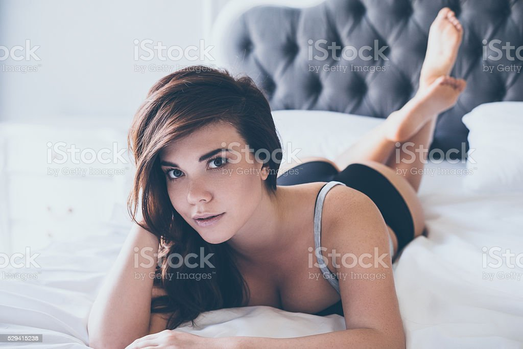 Seductive beauty in bed. stock photo