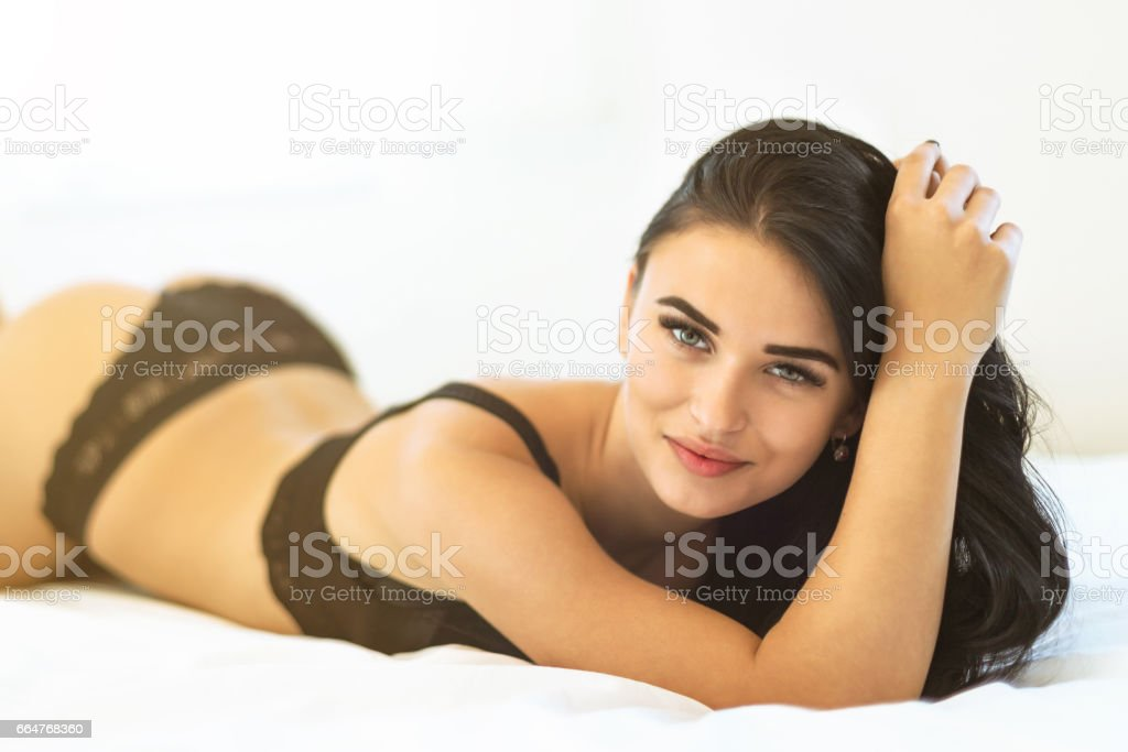 Seductive beauty in bed stock photo