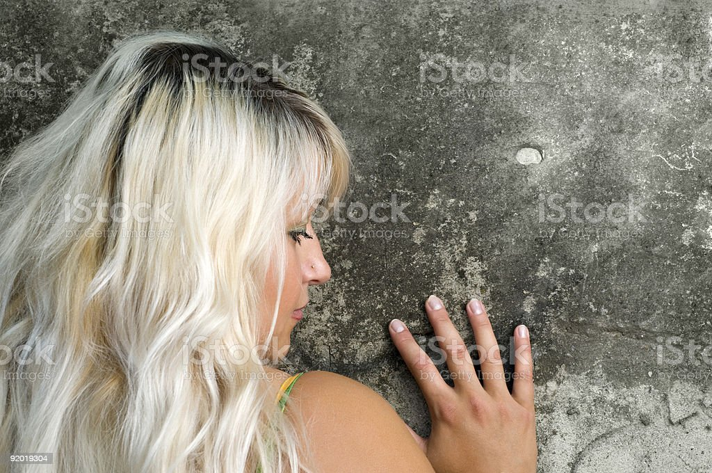 seductive blond and wall stock photo