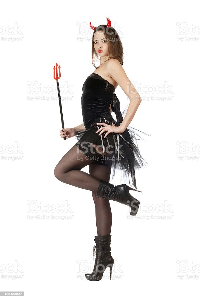 Seductive girl is wearing a devil costume royalty-free stock photo