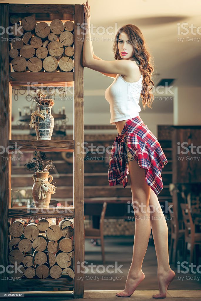 Seductive girl posing in bar stock photo