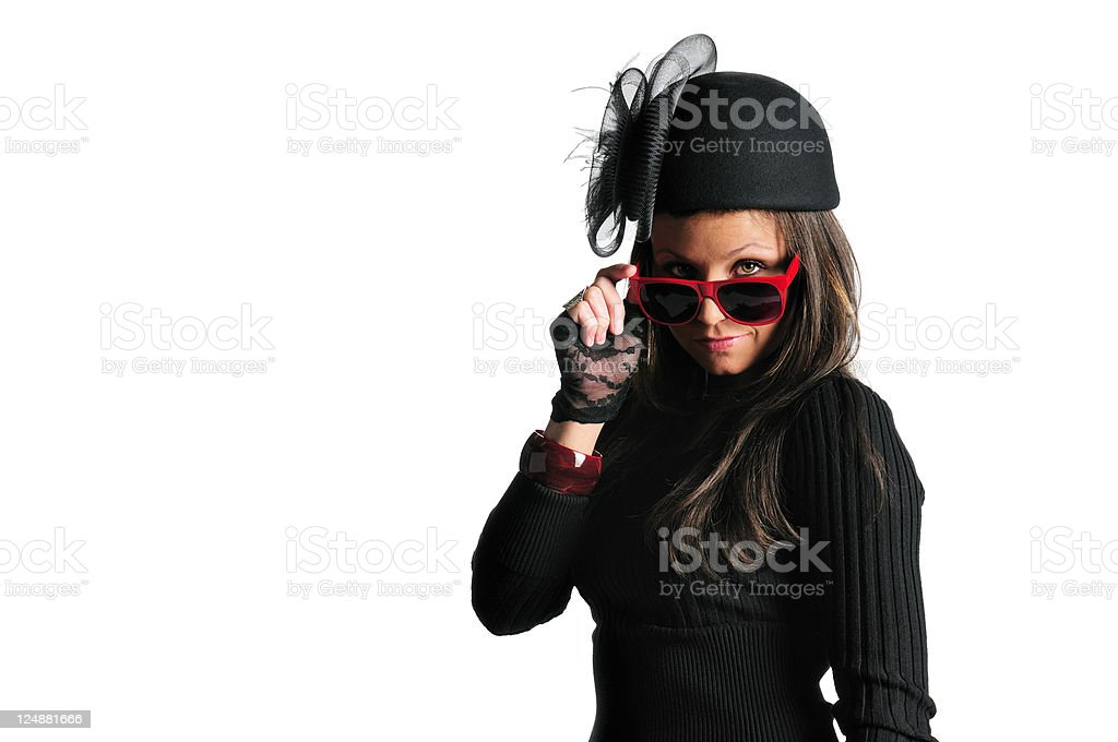 Seductive Looking Lady In Fancy Black Hat and Red Sunglasses stock photo