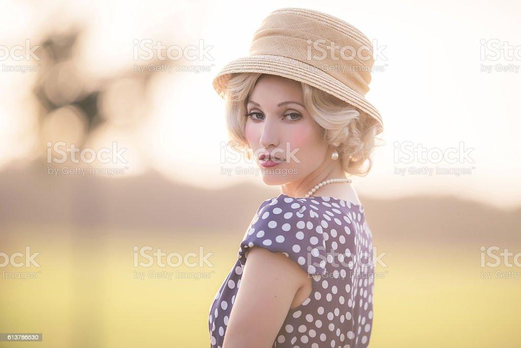 Seductive looking woman wearing vintage 1930s fashion. stock photo