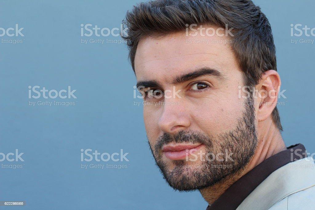 Seductive man flirting with the camera stock photo