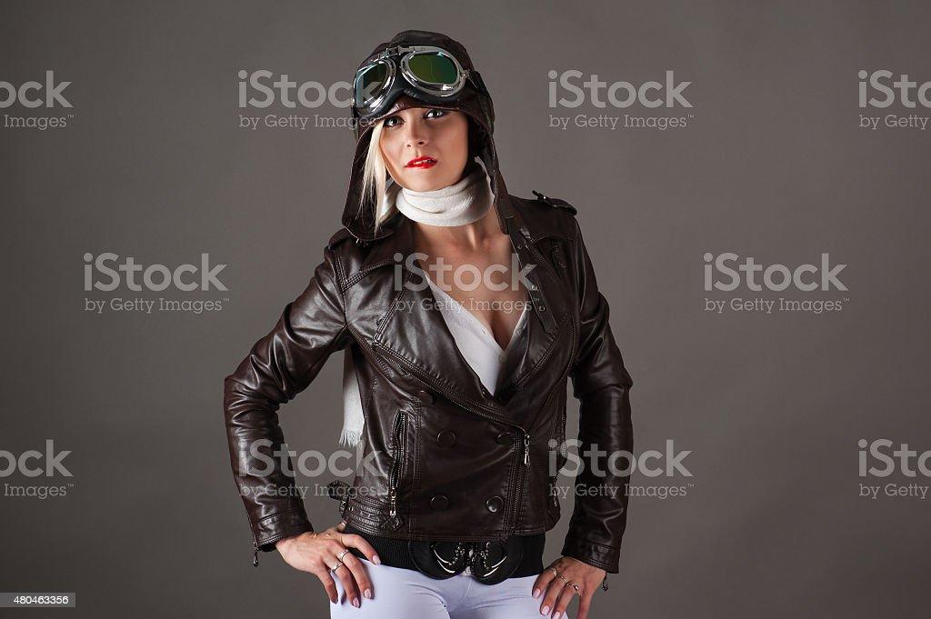 seductive woman in aviator helmet stock photo