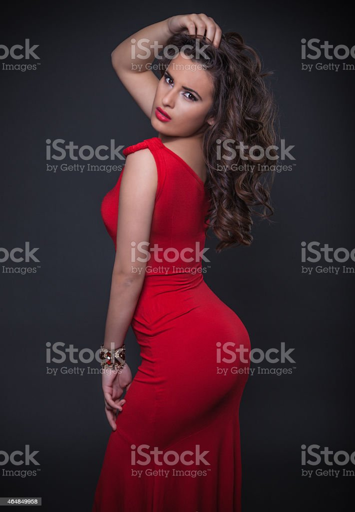 Seductive  Woman In Red Dress stock photo