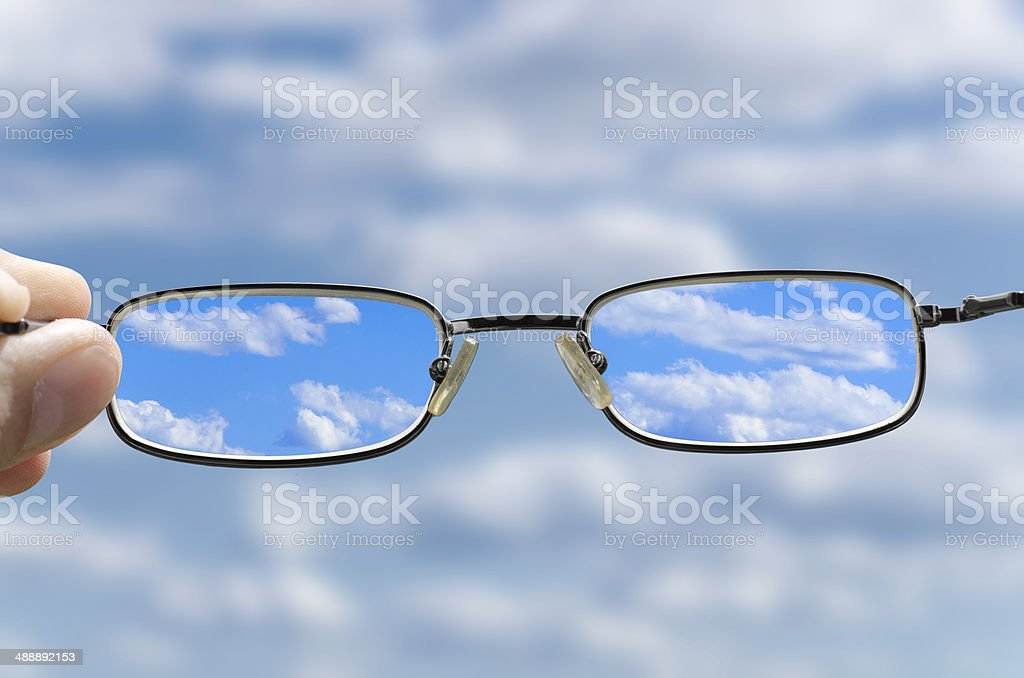 see the sky through glasses stock photo