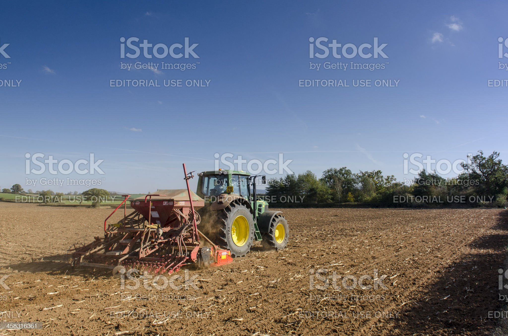 Seed drilling, tractor planting crops royalty-free stock photo