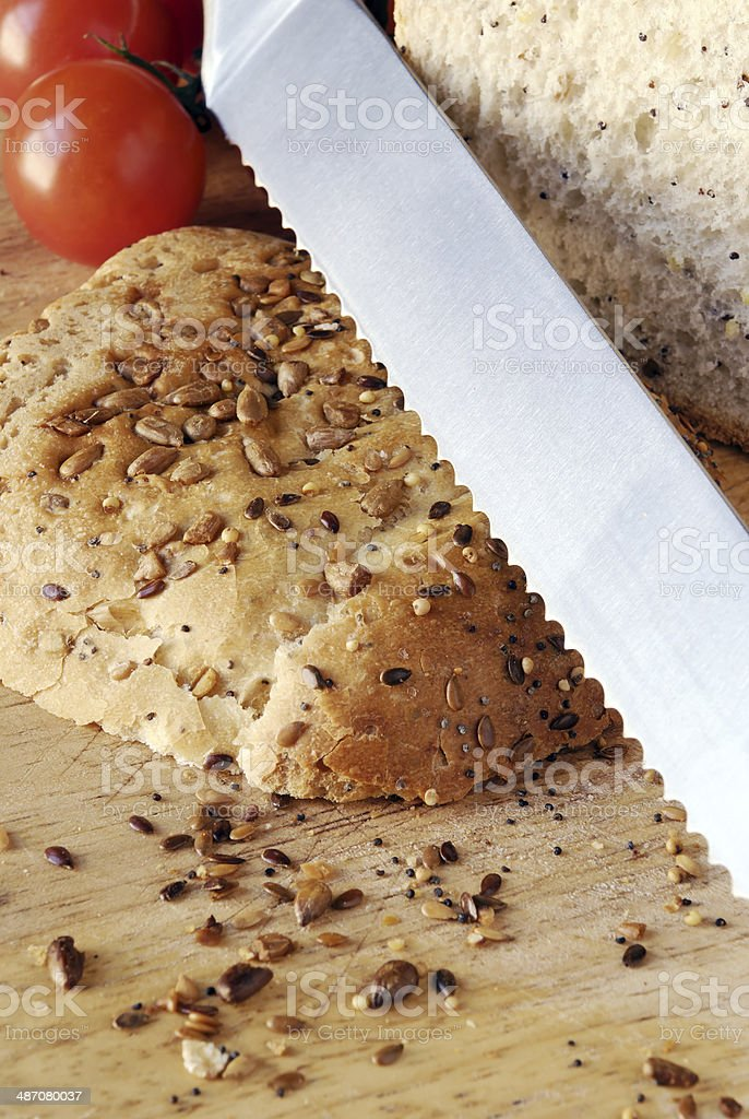 seeded bread on wooden board stock photo