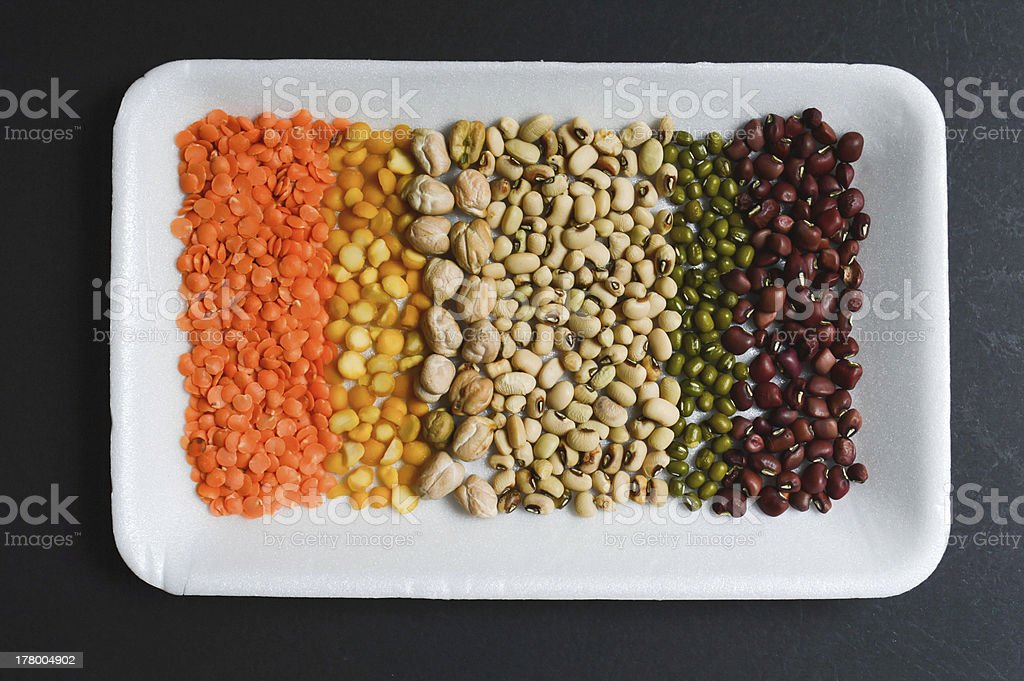 seeds, grains on white plate in black background top view royalty-free stock photo
