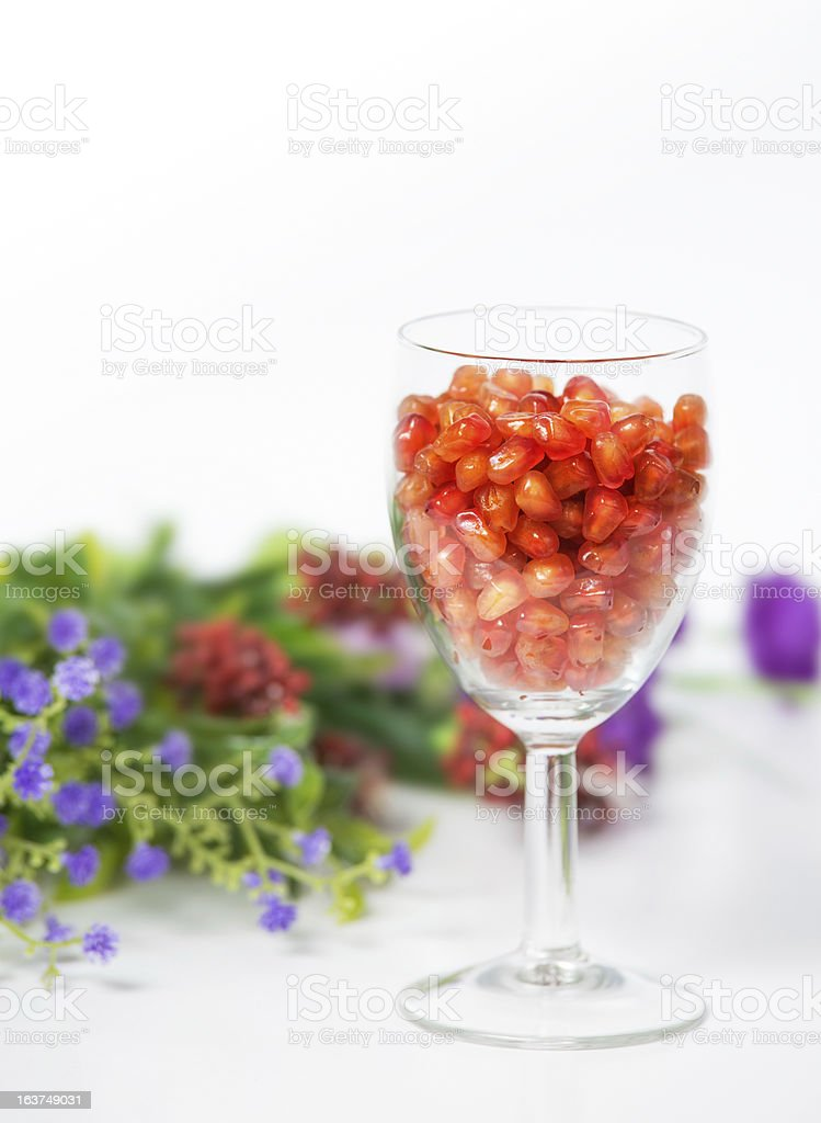 Seeds pomegranate in glass royalty-free stock photo