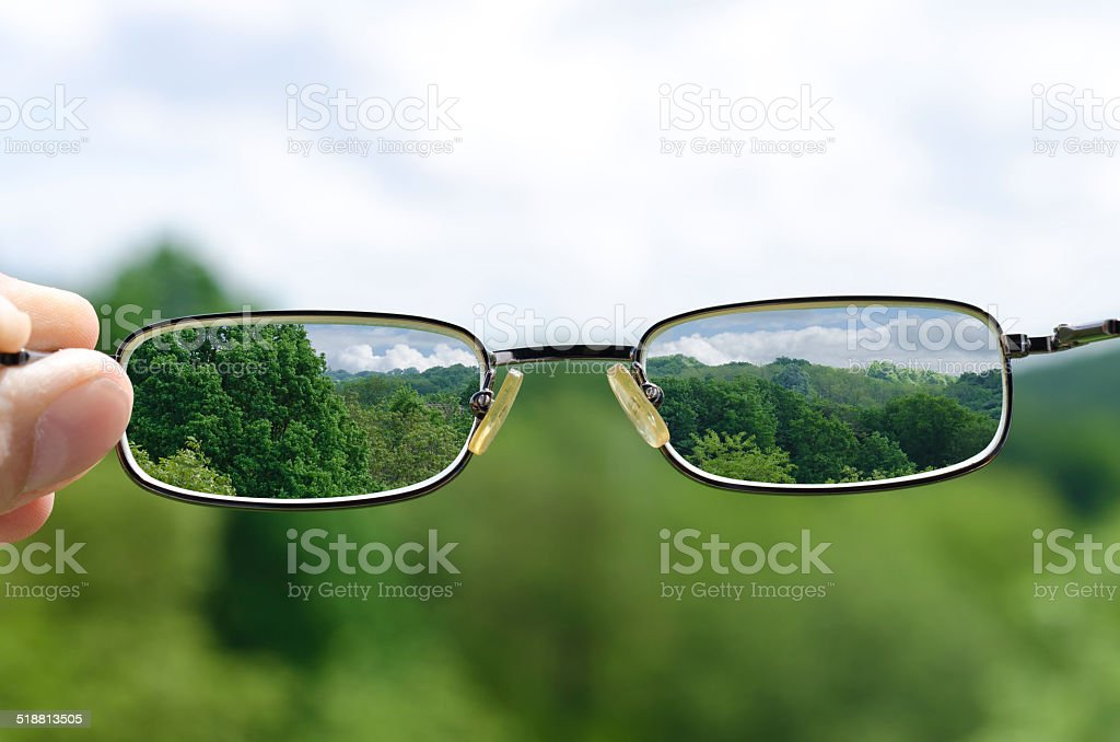seeing nature through the glasses stock photo