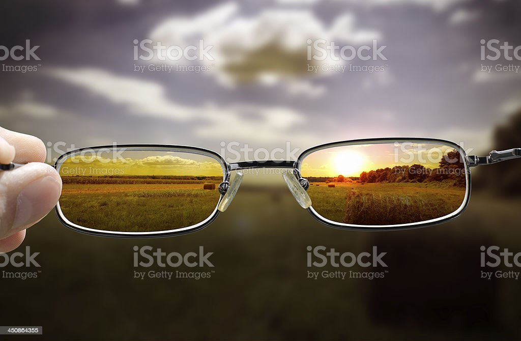 seeing sunset through glasses stock photo