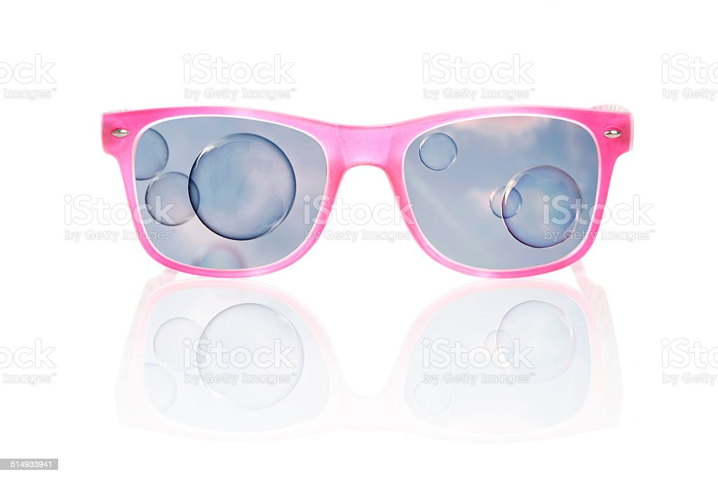 Seeing the world through rose colored glasses. stock photo