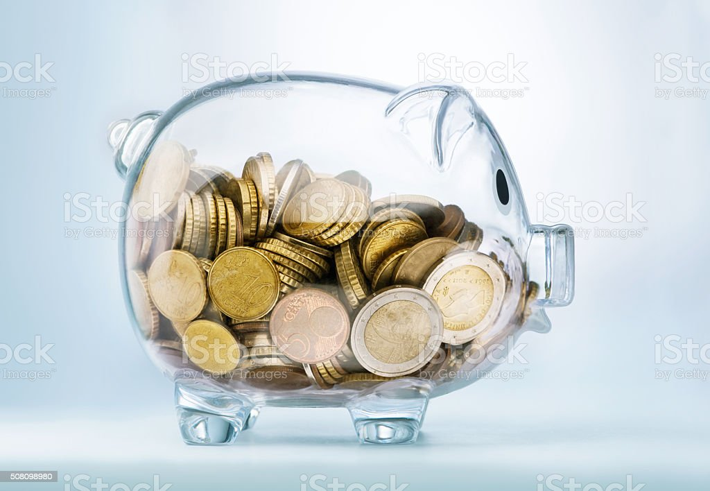 Seeing through piggy bank stock photo