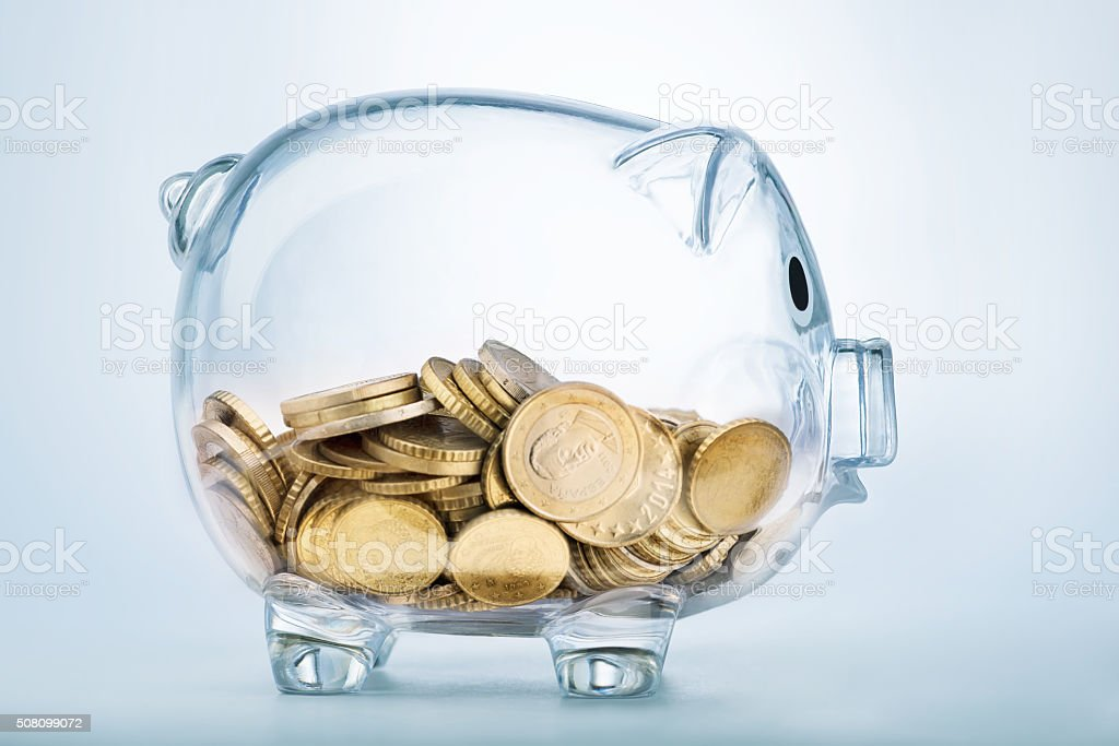 Seeing through piggy bank stock photo