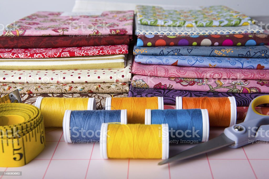 Seeing workspace including scissors, fabric and tape measure stock photo
