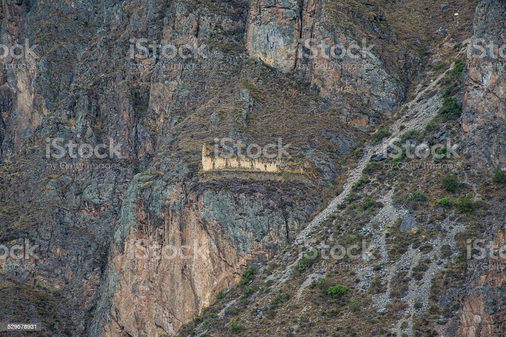 seemingly unreachable barn of Inca's in the mountains, Ollantaytambo stock photo