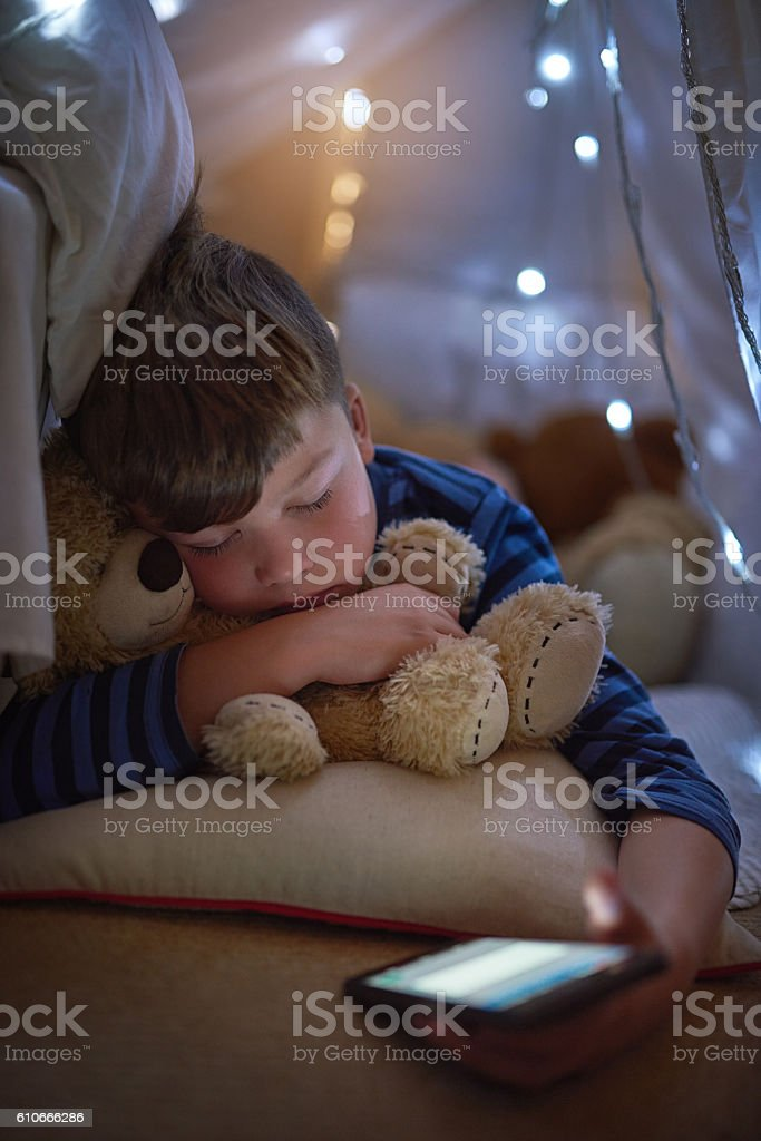 Seems like sleep has finally won him over stock photo