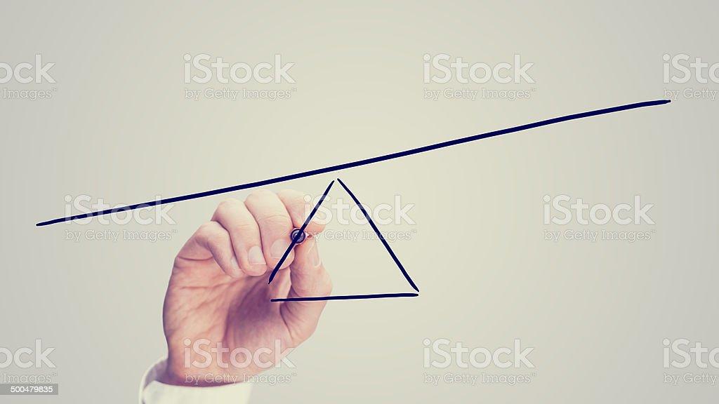Seesaw showing an imbalance stock photo