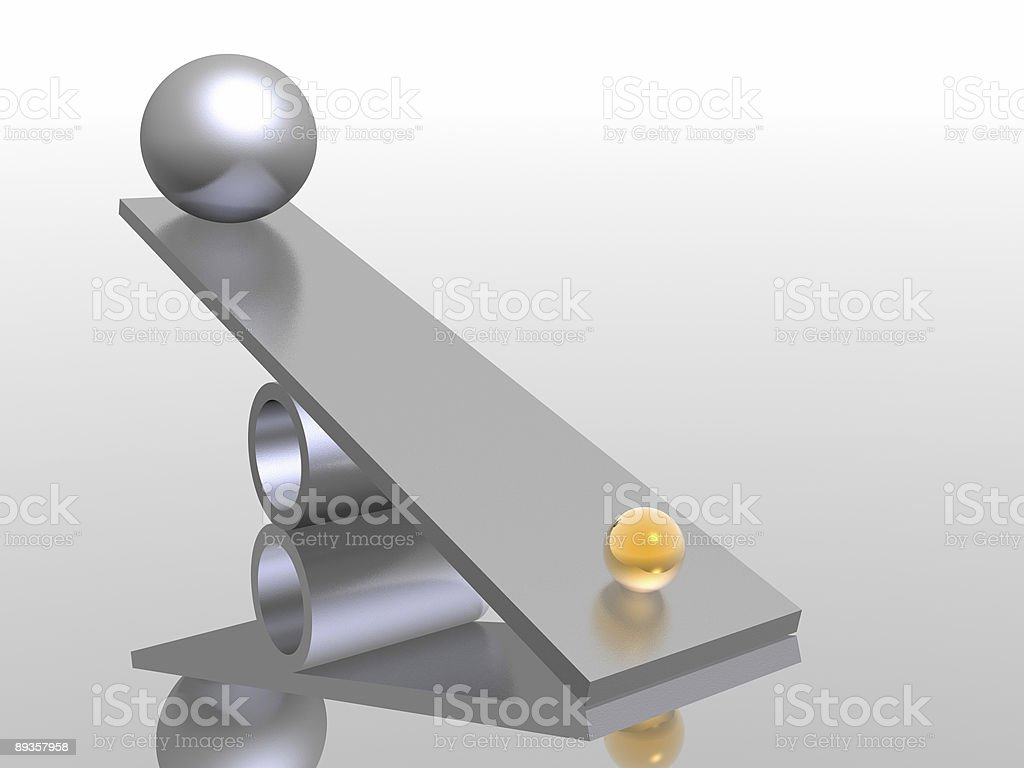 Seesaw system with big and small ball stock photo