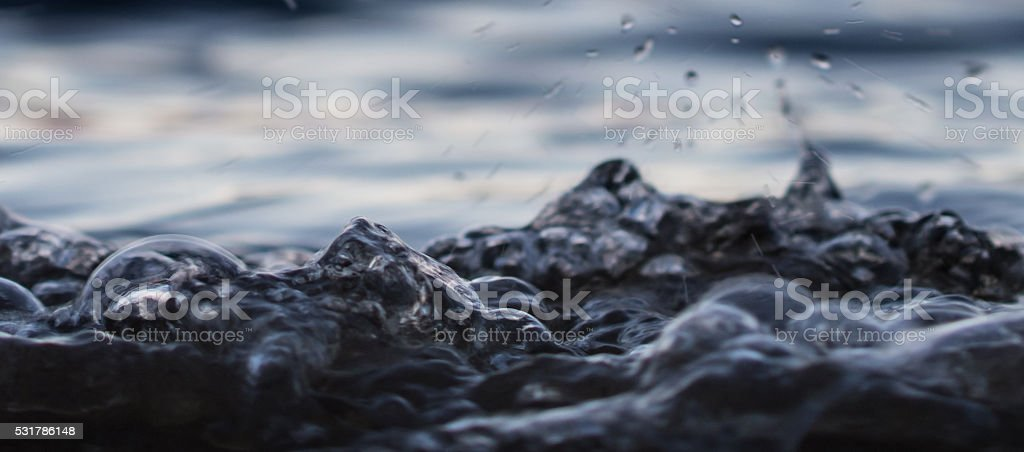 Seething water of lake shore in Karjala Closeup stock photo
