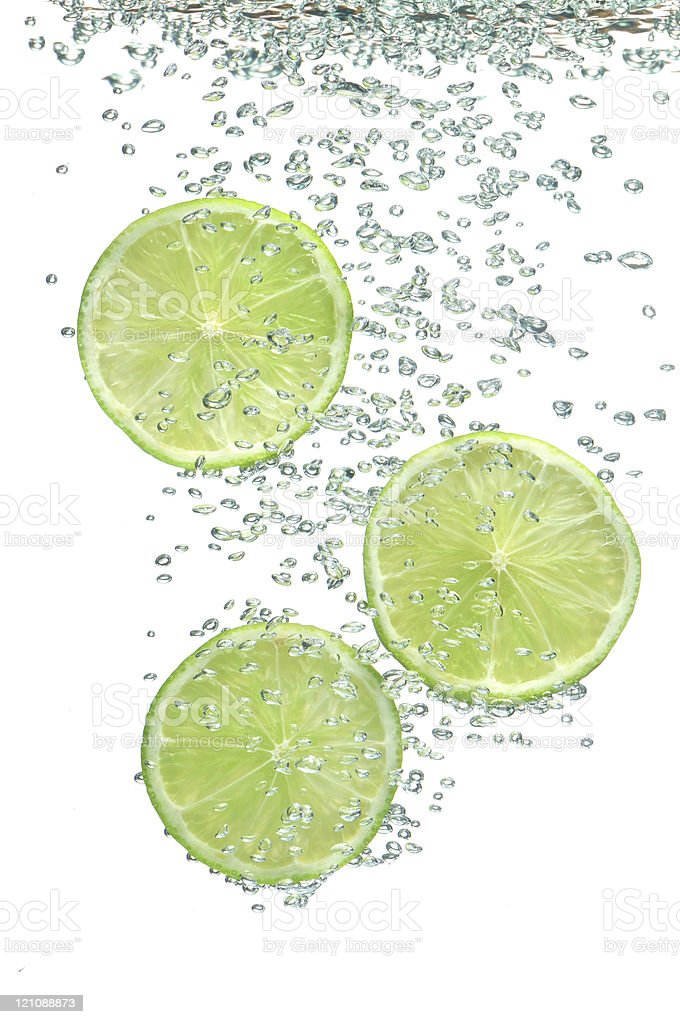 segment of lime in water stock photo