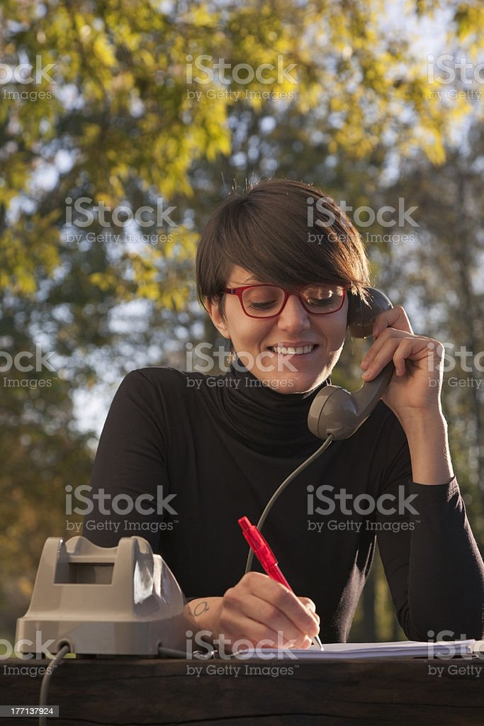 Segratary Woman at the Telephone Outdoor . Autumn royalty-free stock photo