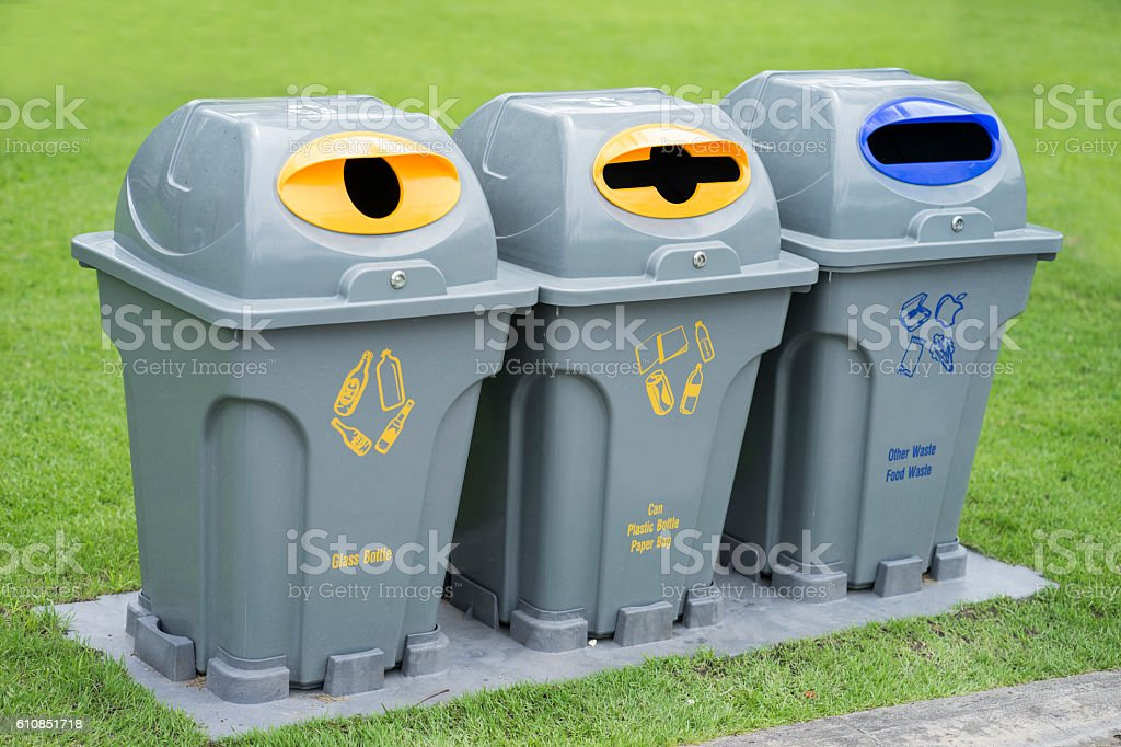 Segregated waste bins for garbage in public park stock photo