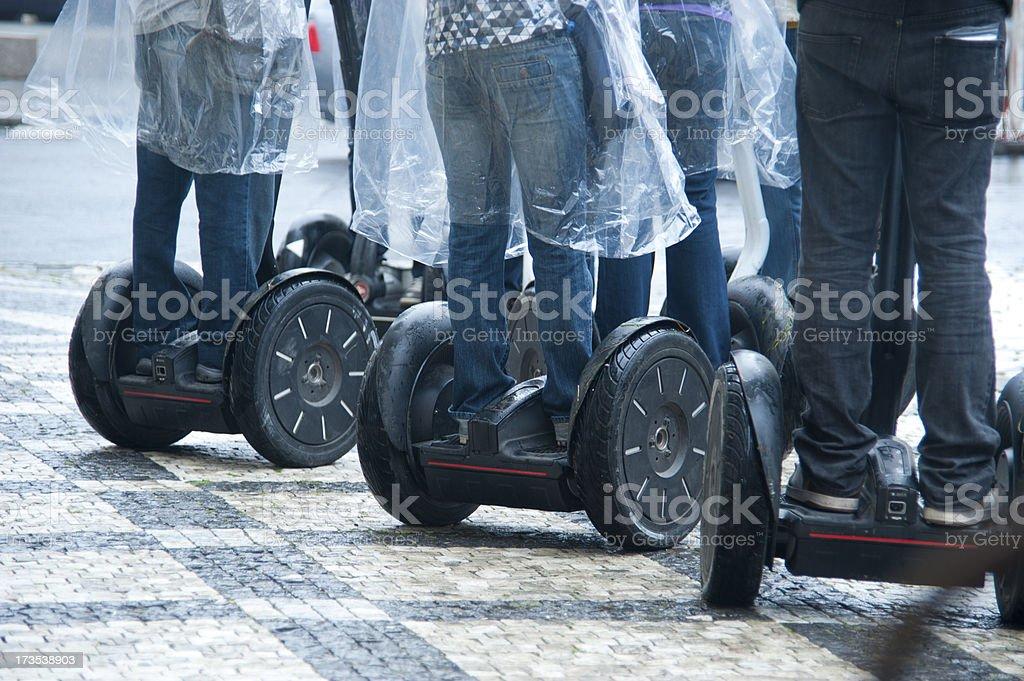 Segways on street in rain stock photo