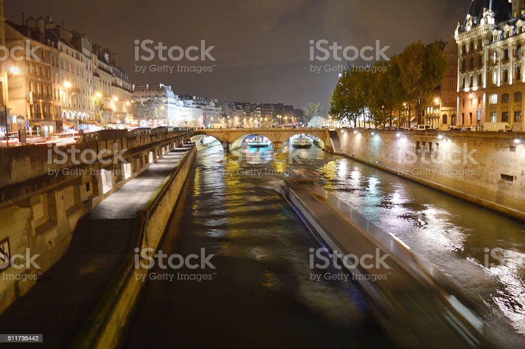 Seine River flowing Paris at night stock photo
