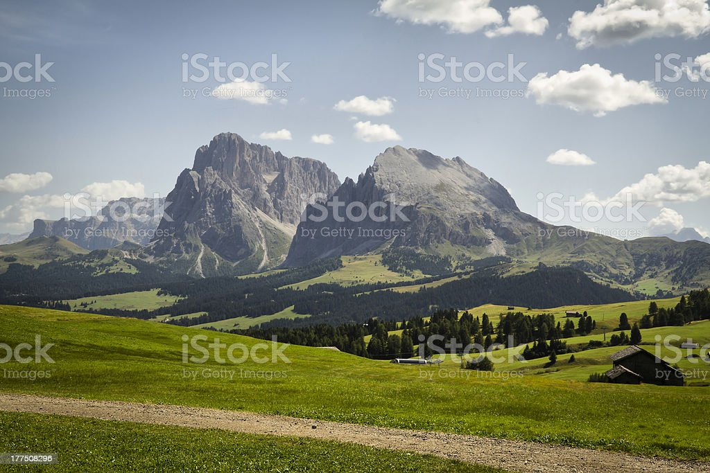 Seiser Alm (Dolomites) - Wood shed with Plattkofel and Langkofel stock photo