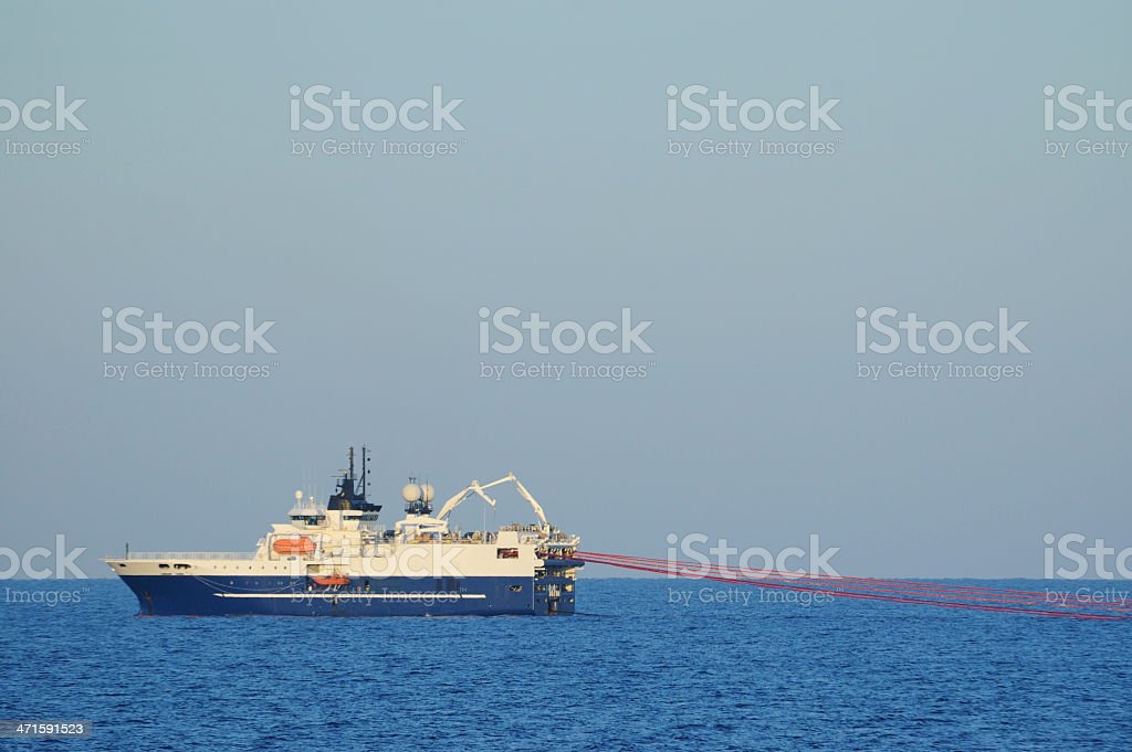 Seismic survey ship towing streamers stock photo