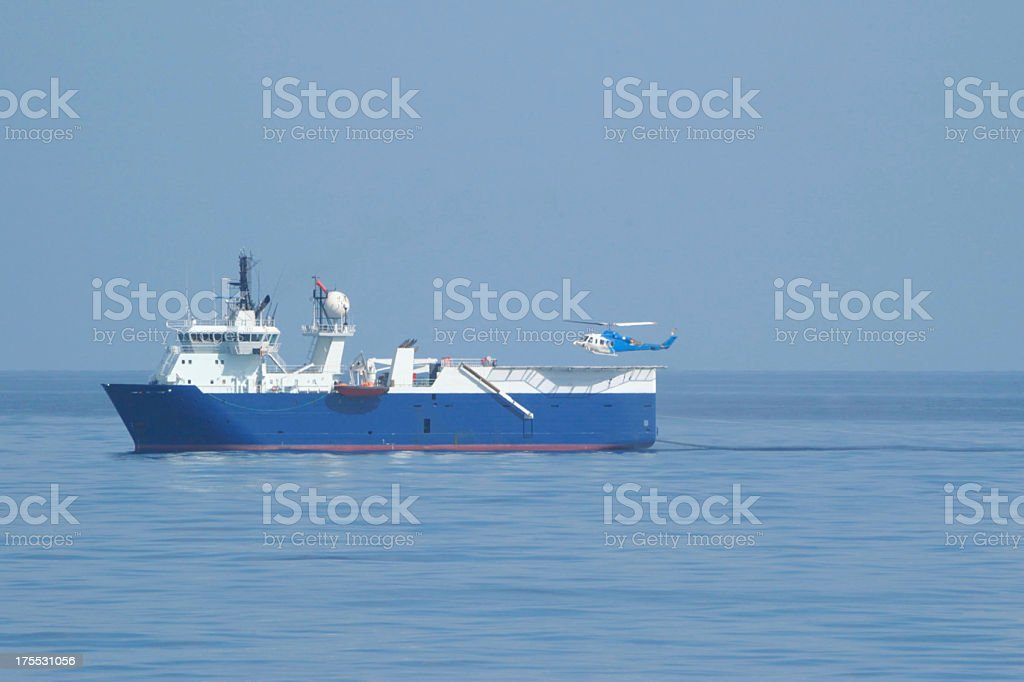Seismic survey ship with helicopter stock photo