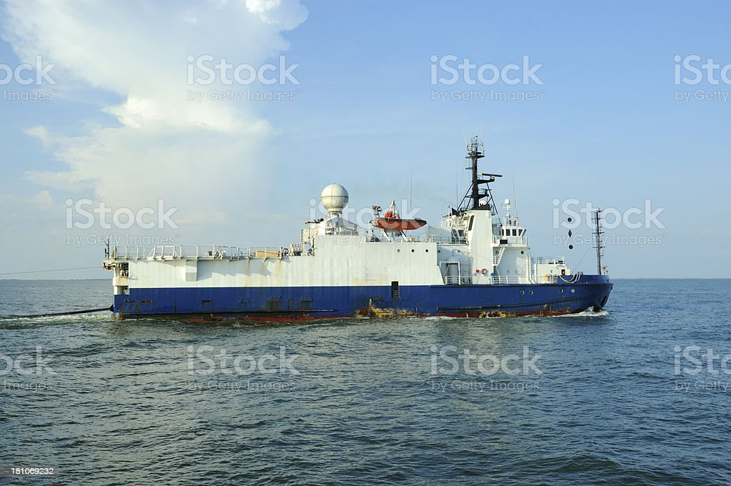 Seismic testing vessel towing cable stock photo