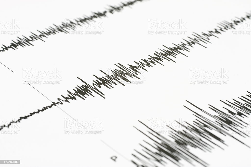 Seismic wave graph on a white paper stock photo