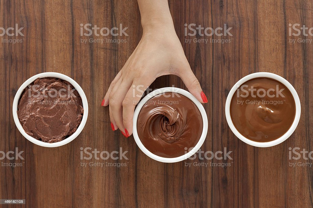 Selecting chocolate desserts royalty-free stock photo