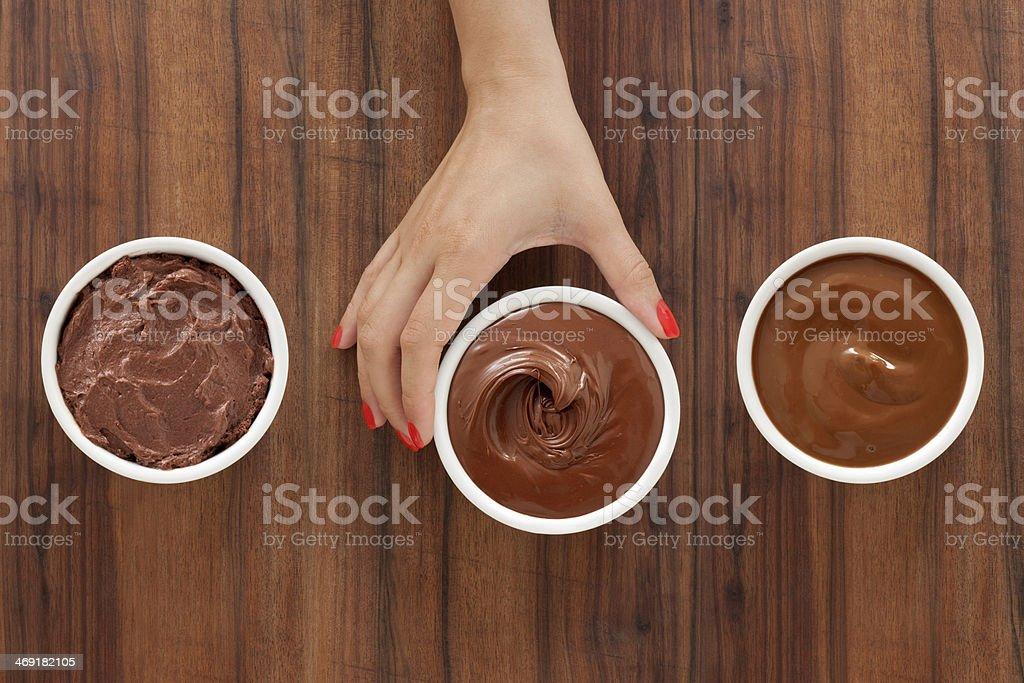 Selecting chocolate desserts stock photo