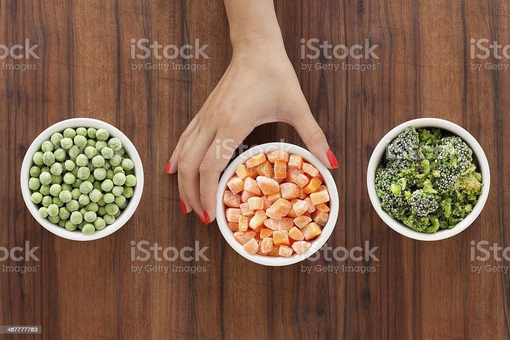 Selecting frozen vegetables stock photo