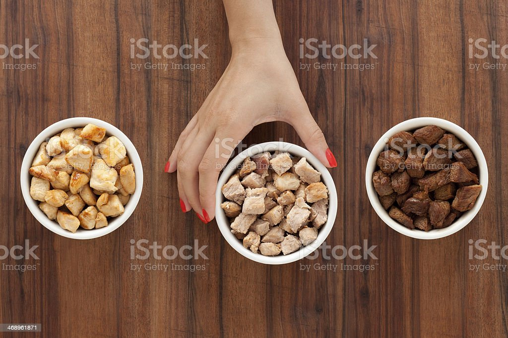 Selecting grilled meat royalty-free stock photo